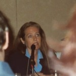 Charlotte speaking at a conference